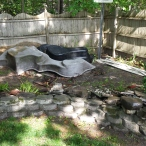Okay, about this. This is a project that we're going to try really hard to get done this summer. We've got a lot of work to do, but we've gotten a lot done already. Someday, this is going to be a two level pond garden with a waterfall, sitting area, and surrounded in trees and bamboo.